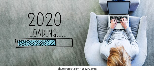 Loading new year 2020 with man using a laptop in a modern gray chair