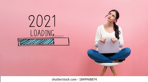 Loading new year 2021 with young woman using a laptop computer