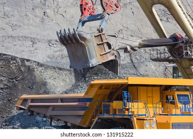 Loading the ore into heavy dump truck at the opencast mining