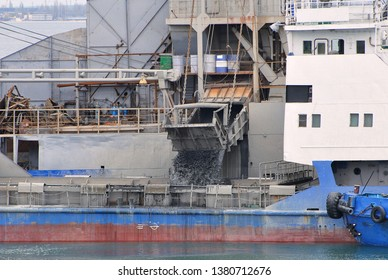 Loading of sea soil from dredger to hopper boat during dredging in seaport