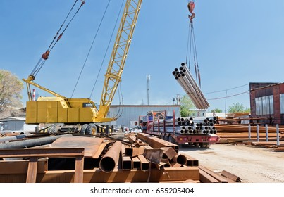 loading of steel products and tubes with a storage area in a special truck with a crane.