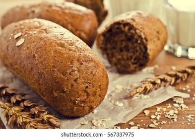 Loaf of black bread with seeds. Selective focus.