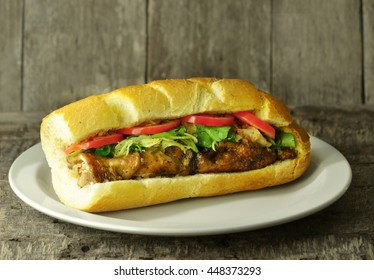 loaf of bread with chicken kebab