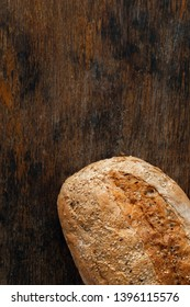 Loaf bread with crisp on wooden table with copy space top view