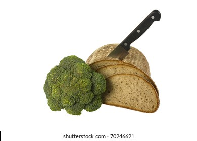Loaf of bread with knife and broccoli isolated over white background