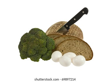 Loaf of bread with knife, eggs and broccoli isolated over white background
