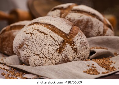loaf of bread on wooden background, food closeup