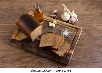 Loaf of bread, salt, garlic, vegetable oil
