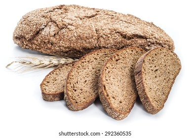 A loaf of bread and slices on a white background.