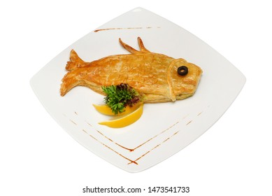 Loaf in the form of fish. Fish-shaped cake on white background. Ruddy fish pie isolated on white isolated background
