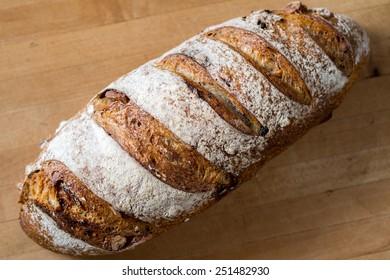 A loaf of fresh cranberry walnut bread