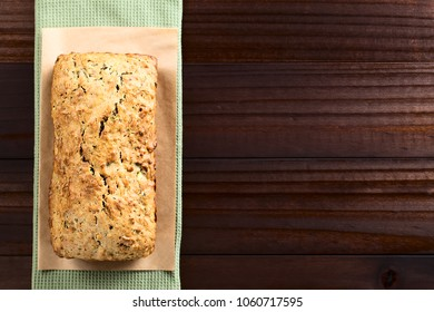 Loaf of fresh homemade zucchini and walnut quick bread (Selective Focus, Focus on the top of the bread)