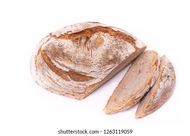 Loaf of organic farmer's bread with slices, isolated on white background.