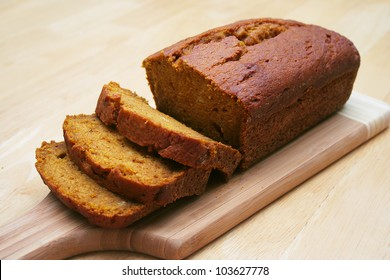 Loaf of Pumpkin Bread Sliced on a Cutting Board
