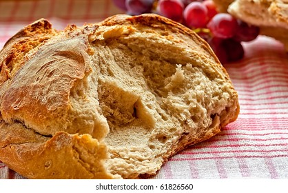 Loaf of rustic bread with grapes