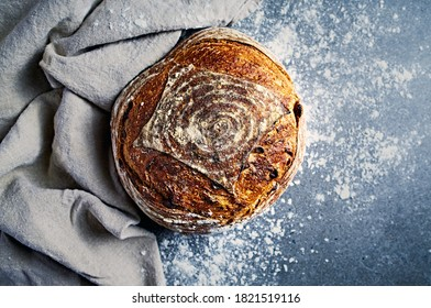 Loaf of rustic rye bread with cranberries. Sourdough bread. From top