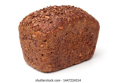 Loaf of rye bread with linseeds and sunflower seeds on white background