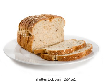 Loaf of sliced bread on plate.  Isolated on white.