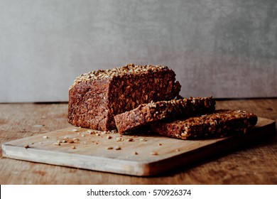 Loaf of sliced rye bread with seeds.
