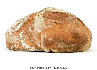 Loaf of sourdough bread isolated on a white background.