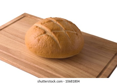 A loaf of sourdough bread on a wooden cutting board isolated against white, with clipping path.