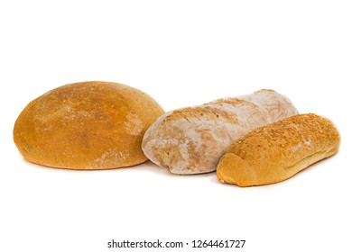 a loaf of white bread, buns and a baguette on a white background