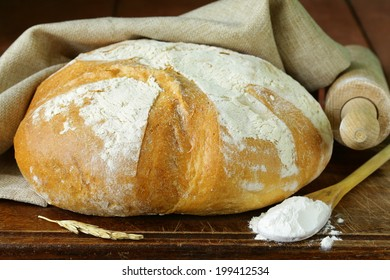 loaf of white bread on a wooden table rustic style