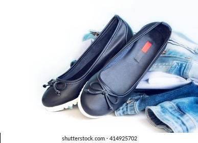 Loafers sleep on female leather blue shoes on white background empty space for text.Jeans clothes & footwear set.