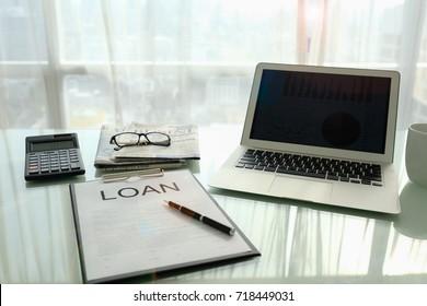 Loan agreement document on desk of bank loan officer. concept of business loan.