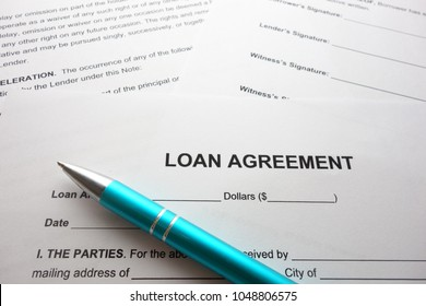 Loan agreement form document and pen
