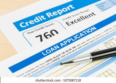 Loan application form excellent credit score with pen