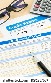Loan application form fair credit score with calculator, glasses, and pen