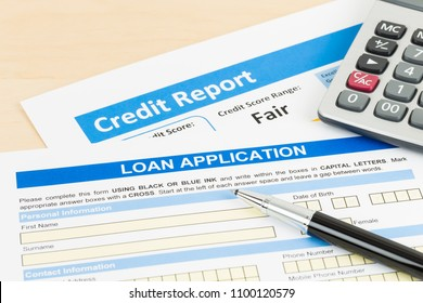 Loan application form fair credit score with calculator, and pen