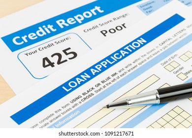 Loan application form poor credit score with pen