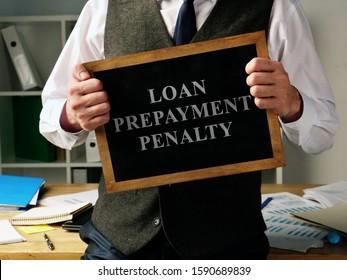 Loan Prepayment Penalty concept. Man is holding blackboard.