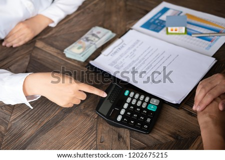 loan repayment calculator woman bank employee stock photo edit now