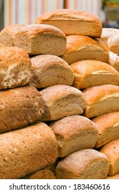 loaves of delicious bread in a market stall
