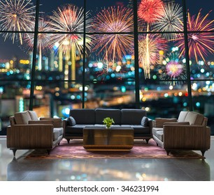 Lobby area of a hotel which can see Fantastic festive new years colorful fireworks on cityscape blurred photo bokeh in celebration night