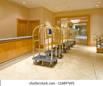 Lobby for the luxury five stars hotel with the luggage carts and the counter.