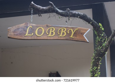 lobby sign board made of wood