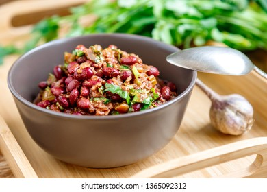 Lobio with red beans. Traditional Georgian dish of stewed beans and walnuts close-up