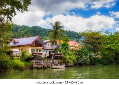 Loboc River and Houses in the Village of Loboc, Bohol, Philippines