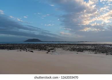 Lobos island, morning view seen from Corralejo Beach on Fuerteventura, Canary Islands, Spain