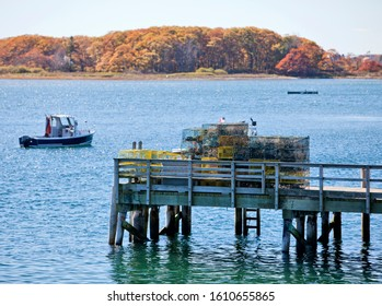 Lobster baskets and fishing boats in Maine, New England, USA