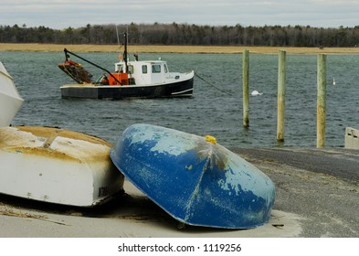 A lobster boat is moored offshore on the coast of Maine.