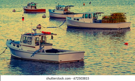 Lobster boats moored in the Sheepscot River at the Wiscasset Waterfront at sunset