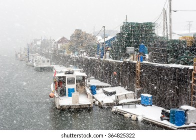 Lobster boats in Portland, Maine harbor during a blizzard