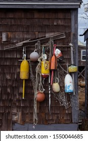 Lobster buoys with fishing nets hanging on a wooden barn wall, New England, Massachusetts coast