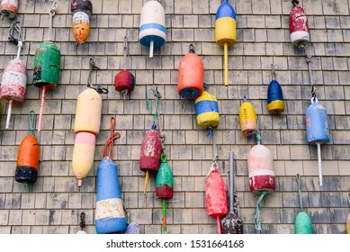 Lobster buoys hanging from a fishing dock in Maine