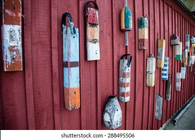 Lobster buoys hung on a wall in a New England town.
